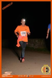 Donna running Equinox 24 hour race at night