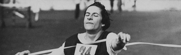 Woman finishing first in a race