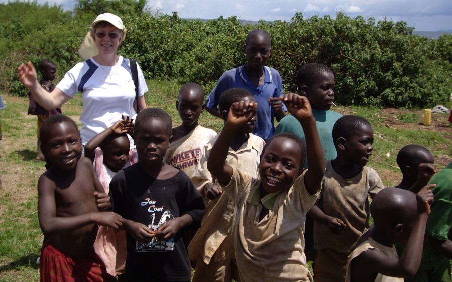 Pam Storey with children in Uganda